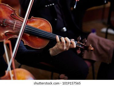 Playing the violin in orchestra