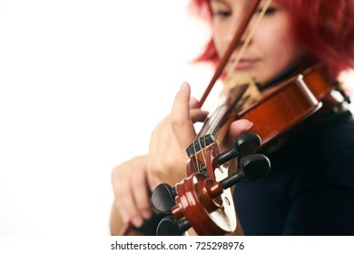 Playing the violin. Young woman playing violin on white background with copy space