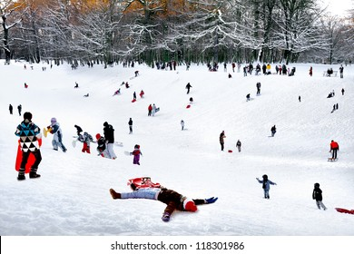 Playing in a winter park. A group of children and adults playing in a winter park.