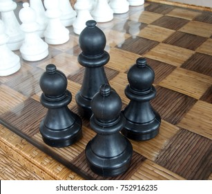 Playing wooden chess pieces. Chess photographed on a chessboard.