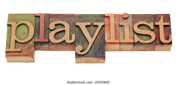 playlist word in vintage wooden letterpress printing blocks, stained by color inks, isolated on white