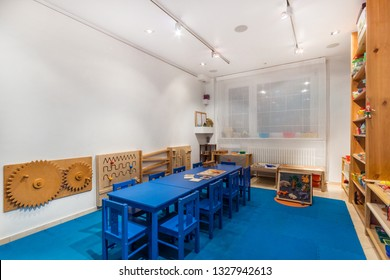 Playroom with a lot of object on table. Art room for education children's creativity.