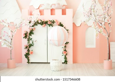Playroom with pink castle tent for children. Children's room for a little princess. Decorations for a children's party. A room with tent, white door and balloon. Kindergarten, games room. interior
