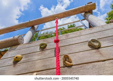 It is a playset in the park. I will go up the red rope.