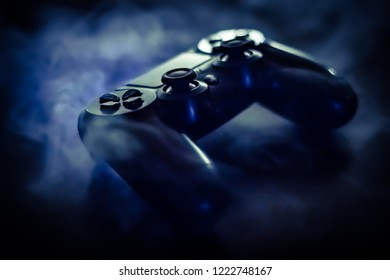 PlayStation 4 controller in blue smoke