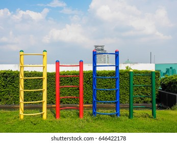 playstructure and playground in park with deep blue sky