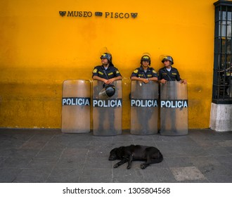 Plaza de Armas, Lima/Peru- January 19, 2019: Police and dog are on duty near the wall of Pisco Museum at Plaza de Armas, Lima, Peru