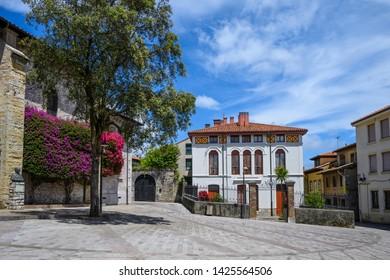 The Plaza de Cristo Rey looking towards Parroquia De Santa María in downtown Llanas, Asturias, Spain.