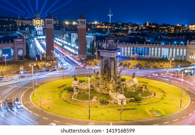 Plaza de Espana after the sunset with a long exposure and visible light trails of passing vehicles. Catalonia, Spain