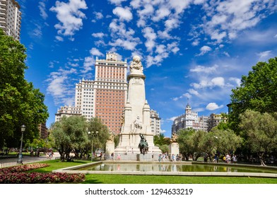 Plaza de Espana in Madrid, Spain, with the Cervantes Monument and Edificio Espana, or Spain building, on a summer day. The large square is a tourist attraction and is located at the end of Gran Via