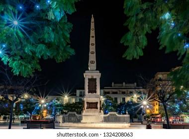 Plaza De La Merced, Malaga, Spain 2019-02-22 : Obelisk At Plaza De La Merced, Malaga, Spain in night