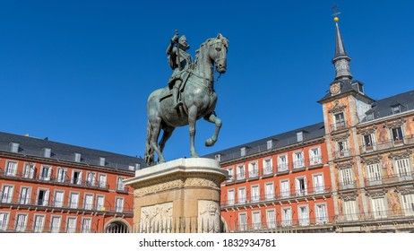 Plaza Mayor - Bright Autumn sunlight shines on the bronze equestrian statue of Philip III standing at the center of Plaza Mayor, Madrid, Spain.