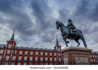 In Plaza Mayor of Madrid, and the statue of Philip III (Felipe III), in Madrid, Spain.
