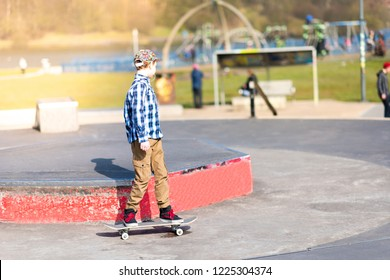 Plaza Skate Park, Stoke on Trent, Staffordshire - 2nd July 2018 - A handsome little energetic boy with ADHD, Autism, Aspergers syndrome having fun skateboarding at the local skatepark,