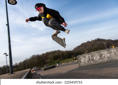 Plaza Skate Park, Stoke on Trent, Staffordshire - 2nd July 2018 - A skateboarder Ollie's off a very high double step at the skate park getting some serious air