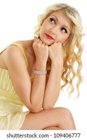 Pleasant blonde with a bright appearance on a white background