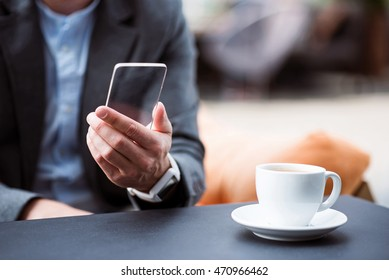 Pleasant businessman sitting in the cafe