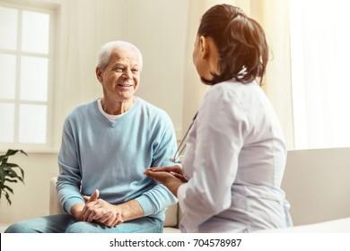 Pleasant cheerful man having a conversation
