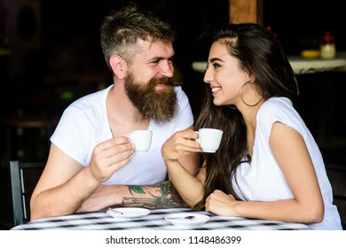Pleasant coffee break. Couple in love drink black espresso coffee in cafe. Couple enjoy hot espresso. Drinking black coffee improves your mood and thus makes you happy. Romantic date in cafe.