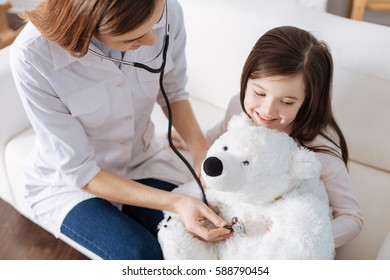 Pleasant doctor conducting examination