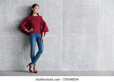Pleasant elegant girl is standing in office