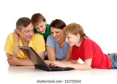 Pleasant family in bright T-shirts on a white background
