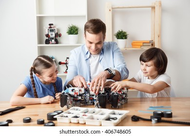 Pleasant  father playing with kids