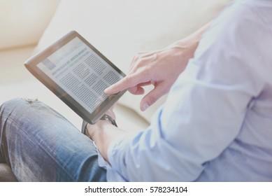 Pleasant man reading news online
