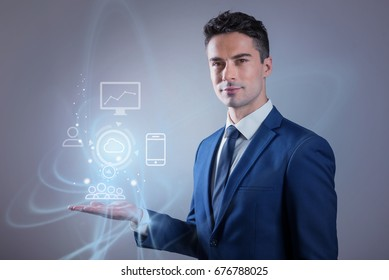 Pleasant man is showing sample of new technology