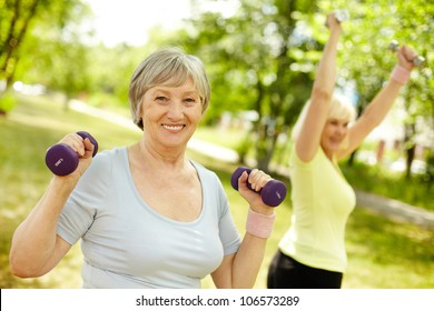 Pleasant mature females working out in the open air