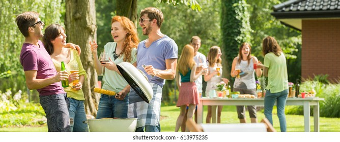 Pleasant meeting of smiled friends at a barbecue