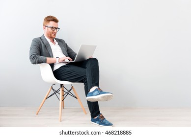 Pleasant positive business man using laptop