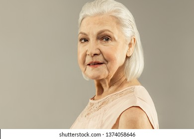 Pleasant smile. Portrait of a joyful positive aged woman smiling to you