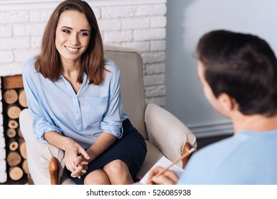 PLeasant smiling woman alkign with psychologist.