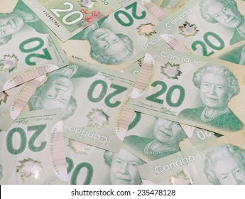 PLEASANT VALLEY, CANADA - NOVEMBER 30, 2014: The Canadian twenty dollar note is a banknote of the Canadian dollar. The Frontier Series banknote was released in 2012.