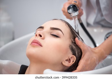 Pleasant woman sitting in the hairdressing salon