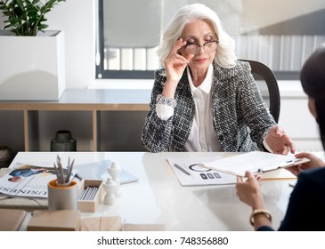 Pleasant women are working together