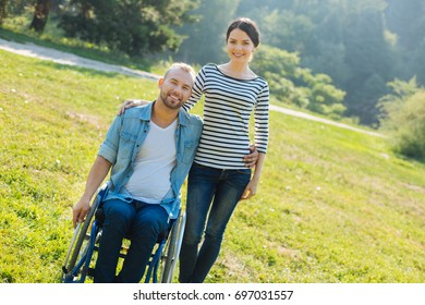 Pleasant young couple posing in the meadow