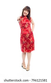 Pleasant young woman in traditional red Chinese dress short sleeve, QiPao, Cheongsam or Mandarin gown.
