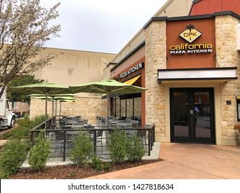 Pleasanton, CA - April 01, 2019: California Pizza Kitchen storefront. California Pizza Kitchen is a casual dining restaurant chain known for its innovative and nontraditional pizzas.