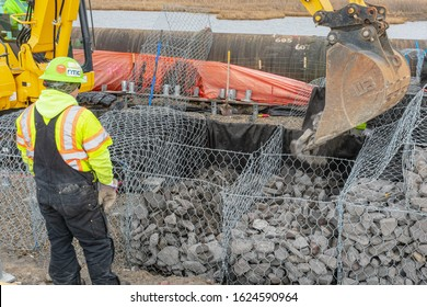 Pleasantville, NJ / USA - November 27, 2019: Constructing a gabion wall for the creation of a service road near East Delilah Road.