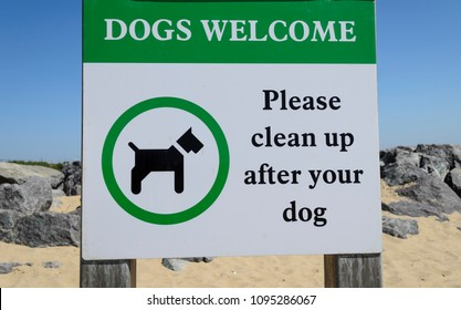 please clean up after your dog sign on the beach UK
