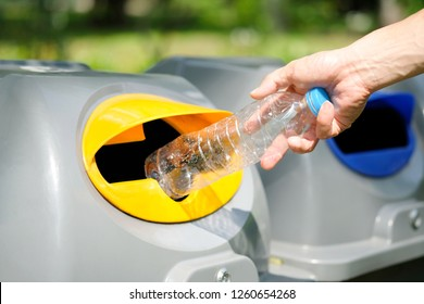 Please dispose of plastic bottle into the tank. A man throw rubbish in the trash can by separate garbage to dispose like hazardous waste , recyclable waste , wet waste, dry waste for reuse.