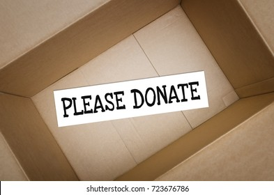 Please donate. Empty donation box top view. Concept of charity.
