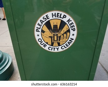 please help keep our city clean sign on green trash can