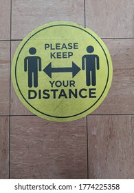 Please keep your distance yellow floor sign