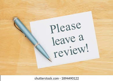 Please leave a review card with a pen on a desk