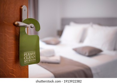 Please make up my room. Maid cleaning the room with please make up my room sign on the door. Opened door of hotel room in morning.Hotel, door open. Clean and elegant accommodation service.