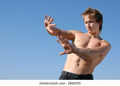 Please! No! Young shirtless man holding his hands out saying 'No'
