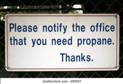 A please notify office for propane sign.